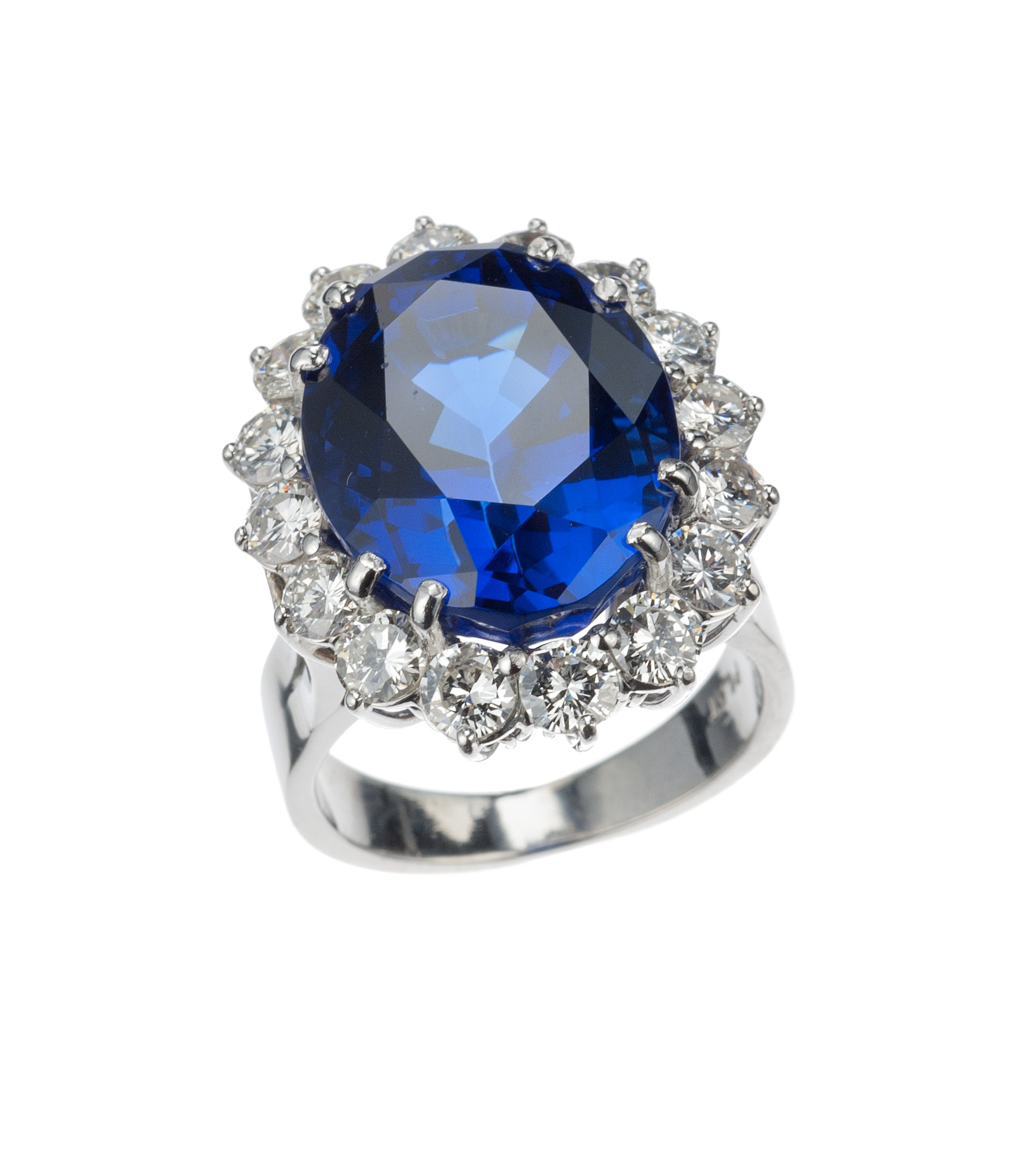 Tanzanite and diamond halo ring in platinum