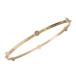 Narrow gold and diamond bangle